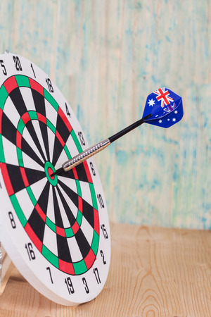 Darts arrow with Australia flags on red dart board