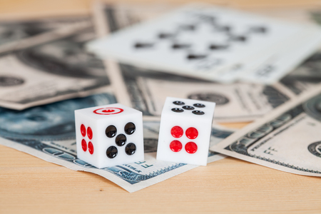 two us dollar: Two dices on wood table with US dollar and card