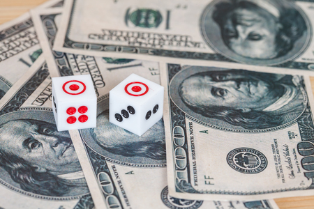 two us dollar: Two dices on wood table with US dollar