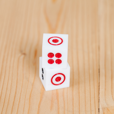 luckiness: Two dice on wooden table
