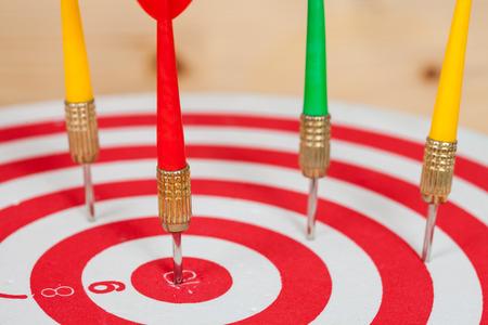dart arrow and dartboard on wood background Stock Photo