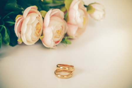 ring tones: Wedding rings on table with vintage tone