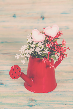 Heart shape with red watering can.Still life of love  concept.