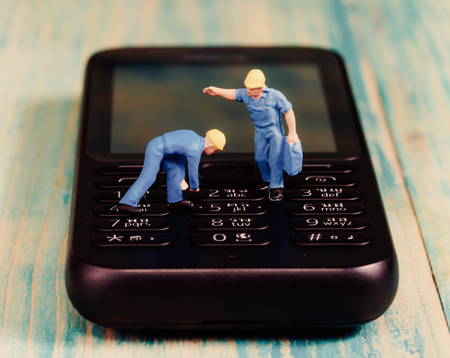 miniature people: Miniature people working on mobile ,selective focus Stock Photo