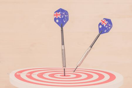 Darts arrow with Australia flags on red dart board ,  white background Stock Photo