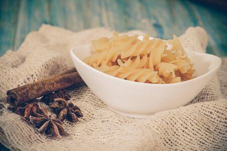 tallarin: spiral raw macaroni pasta
