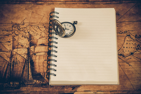 old paper background: Antique watch on book wooden background.Vintage style.