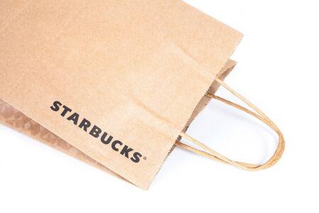're: Bangkok, THAILAND - January 8, 2017 : Re-use Paper bag of Starbuck Coffee logo favorite Beverages at Bangkok , Thailand.