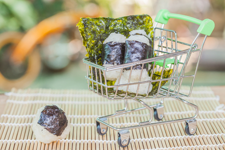 rice ball food design in cart on wood