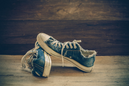 messy clothes: still life old shoes on wood