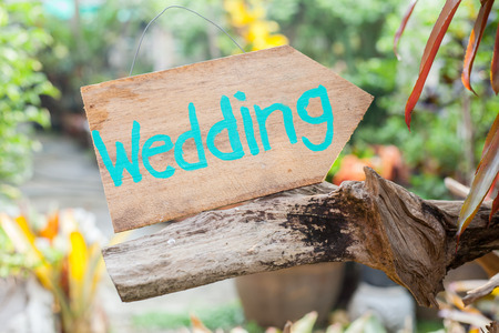 Wooden signboard with the inscription in  paint wedding. Wood hand made wedding decoration table.