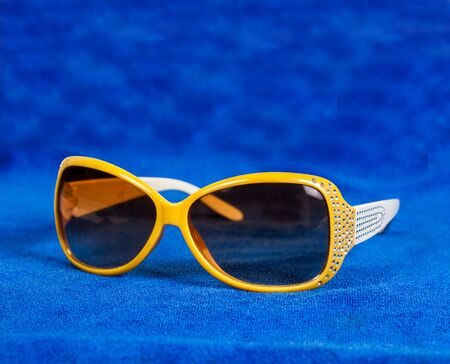 modern sunglasses on white background . Stock Photo