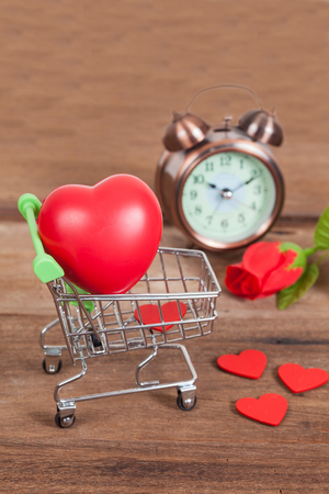 shopping cart and old clock ,time to shopping online
