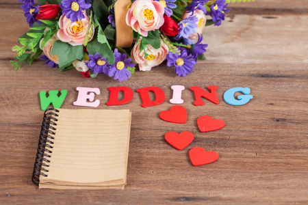 color wedding letters on wood with booknote