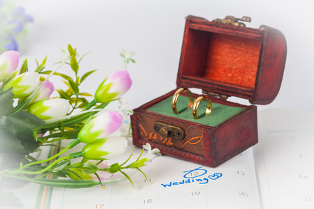Duo ring in box with Wedding note on a calendar sets a reminder for the wedding day
