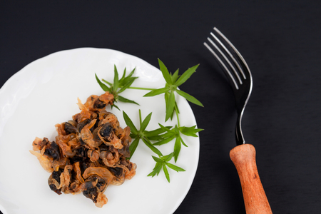 sea food sweet dried clams on dish with fork Stock Photo