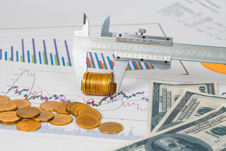 vernier measuring money coin on business chart ,business concept. Stock Photo