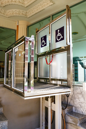 Lifts for the disabled and wheel chair to top floor. Banco de Imagens