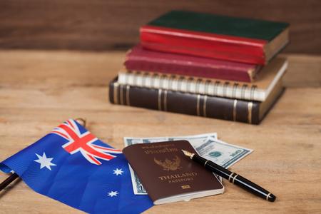 Education in Australia concept,passport on Australia flag 版權商用圖片