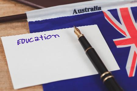 Education in Australia concept,passport and white note on Australia flag .