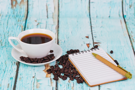 book note with a coffee bean ,concept test a coffee. Standard-Bild