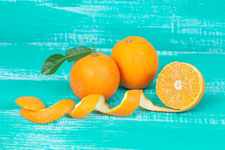 orange fruit on color table background. 스톡 콘텐츠
