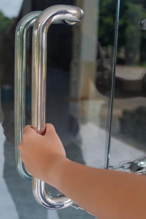 Human hand hold a door handles but door locked. Banque d'images