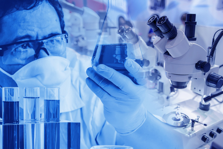 Double exposure Scientist in laboratory to research with test tube , science concept.