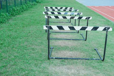 old sport hurdle race on green field.