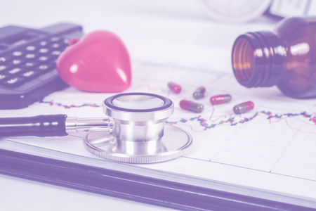Stethoscope with red heart on white table .Medical accessories with copy space. Stok Fotoğraf