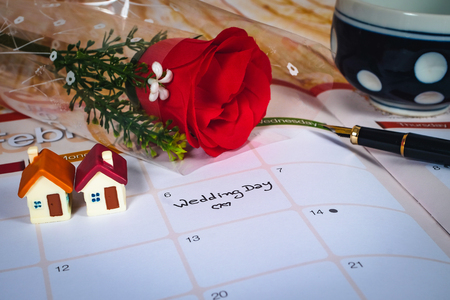 Reminder Wedding day in calendar planning and mini house.