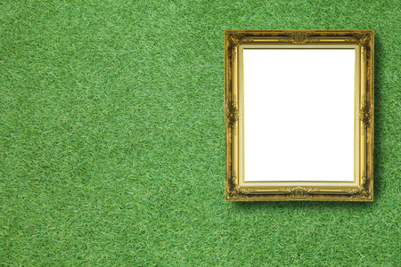 Vintage picture frame on green grass background.