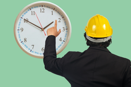 Business man point to analog clock ,business concept.