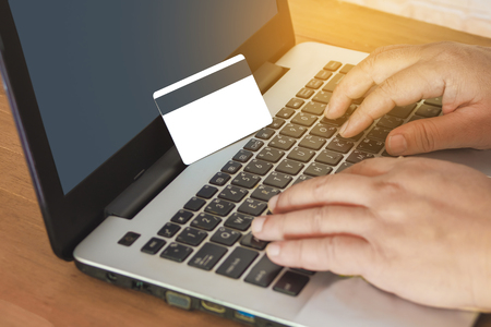 Hand Typing On Laptop Keyboard With Credit Card, Online Shopping Concept .