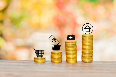 Small icon with coins stacked with bokeh background.