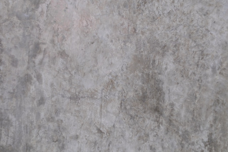 Old grungy texture, grey concrete or cement wall with loft style pattern for background.