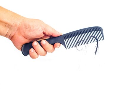 Hand show comb for presentation hair loss problem and looking at hair .