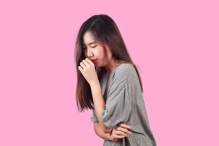 woman suffers from Coughing cold, health concept. Imagens