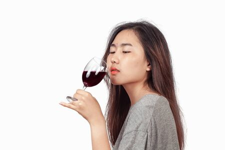Woman feel happy with wine glass in hand.