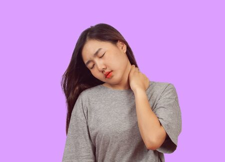 Woman feeling neck pain, massaging tense muscles,Aches and pains    concept.