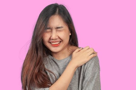 woman suffers from shoulder pain, health concept. Stock Photo