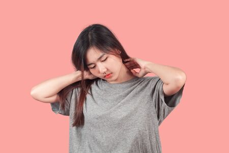 Woman feeling neck pain, massaging tense muscles,Aches and pains concept. Stock Photo