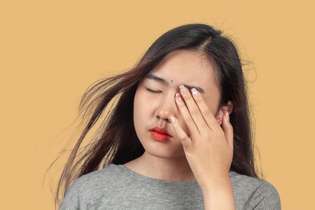 woman suffers from sore eyes, health concept.