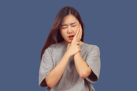 woman suffers from tooth ache, health concept. Imagens