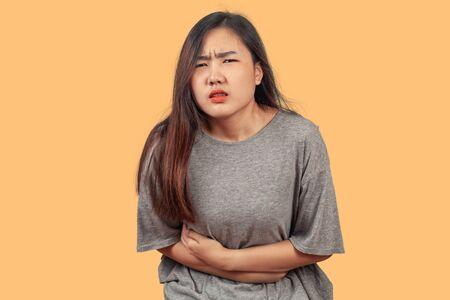 woman suffers from stomach ache, health concept. Banco de Imagens