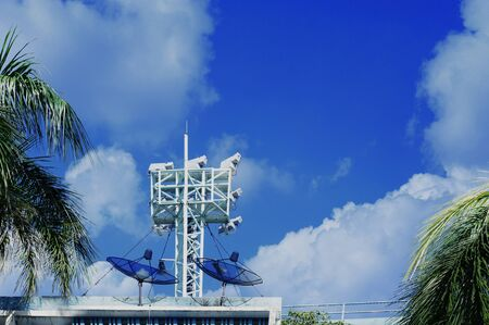 Tower with antennas of cellular communication on blue sky.