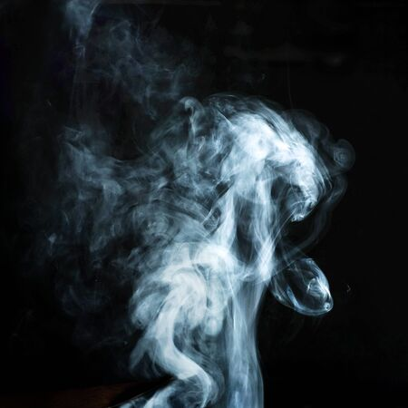 Abstract white smoke effect isolated on black background.