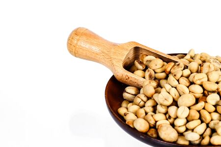 Fresh Raw coffee beans in wood dish on white background.
