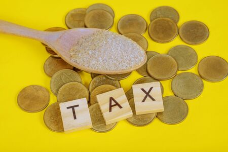 Sugar Tax is a tax or surcharge designed to reduce consumption of drinks with added sugar. Stock Photo