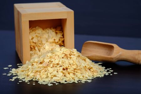 Cornflakes in wood box on a dark wooden background and copy    space.